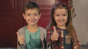 Brother and sister together with giving a thumbs up of support and success stock video footage