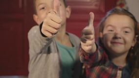Brother and sister together with giving a thumbs up of support and success stock video