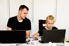 Brother and sister together with laptop computers stock photography