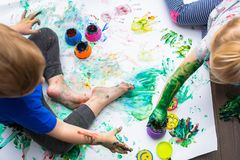 Brother and sister twins learn how to paint Royalty Free Stock Photos