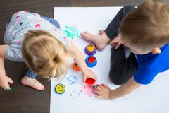 Brother and sister twins learn how to paint Stock Image