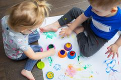 Brother and sister twins learn how to paint Stock Images