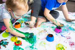 Brother and sister twins learn how to paint Royalty Free Stock Photo
