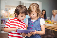 Brother and sister using digital tablet Royalty Free Stock Photo