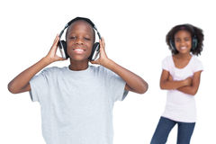 Brother and sister using headphones Royalty Free Stock Images