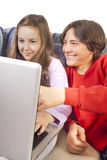 Brother and sister using laptop Royalty Free Stock Image