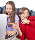 Brother and sister using laptop Stock Images