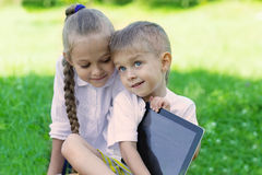 Brother and sister using tablet PC Stock Photography