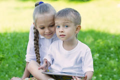 Brother and sister using tablet PC Royalty Free Stock Images