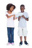 Brother and sister using tablet pc Royalty Free Stock Photography