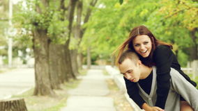 Brother and sister walk along the sidewalk stock footage