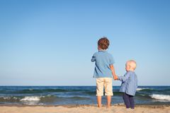 Brother and sister on walk near sea Stock Photography