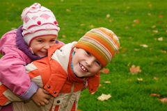 Brother and sister walk in the park Stock Photography
