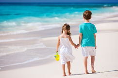 Two kids walking along a beach at Caribbean Royalty Free Stock Image