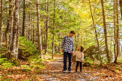 Brother and sister walking along park trail together Royalty Free Stock Photography