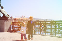 Brother and sister walking on quay in summer Royalty Free Stock Photos