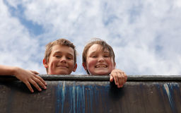 Brother and sister on wall Stock Photo