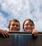 Brother and sister on wall Stock Photography