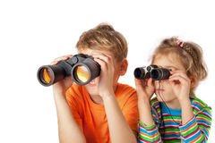 Brother and sister watching through binoculars Royalty Free Stock Image