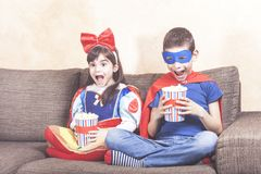 Brother and sister watching movies at home stock photos