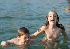 Brother and sister in the water Stock Photography