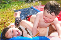 Brother and Sister in Waterplay Stock Photography
