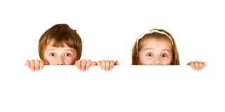 Brother and sister with white board Stock Images