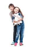 Brother and sister wit big toys Royalty Free Stock Photography