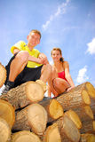 Brother and sister on wood. Pale Royalty Free Stock Photos