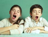 Brother and sister yawning close up portrait Royalty Free Stock Photo