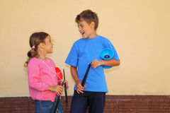 Brother and sister with yo-yo toy. Look at each other and laugh outdoor Stock Images