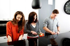Brother and sisters cooking meal together. Stock Photo