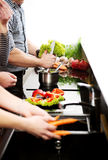 Brother and sisters cooking meal together. Stock Photos