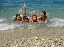 Brother and sisters enjoy on waves Stock Image