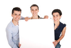 Brother and sisters holding banner Stock Photos