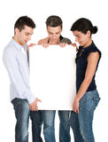 Brother and sisters looking at banner Stock Photos
