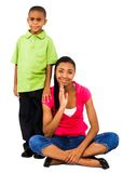 Brother smiling with sister. Brother smiling with his sister isolated over white Royalty Free Stock Photography