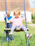 Brother swinging his sister Royalty Free Stock Images