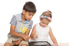 Brother teaches little sister Royalty Free Stock Image