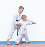 Brother is teaching brother beat punch arm Stock Photo