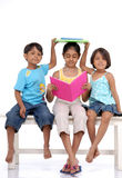 Brother and two sisters with books Stock Photography