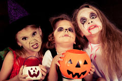 Brother and two sisters on  Halloween Royalty Free Stock Photo