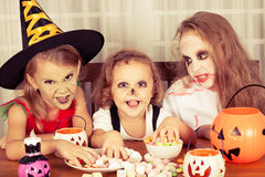 Brother and two sisters on  Halloween Royalty Free Stock Image