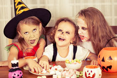 Brother and two sisters on  Halloween Royalty Free Stock Images