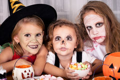 Brother and two sisters on  Halloween Stock Photos