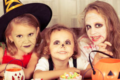 Brother and two sisters on  Halloween Royalty Free Stock Photography