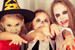 Brother and two sisters on  Halloween Stock Images