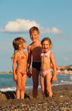 Brother and two sisters are standing on beach Stock Photography