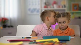Brother whispering secret sister ear, children communication, bad news, gossips. Stock footage stock video