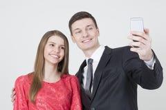 Brother y hermana que toman el selfie Imagen de archivo libre de regalías
